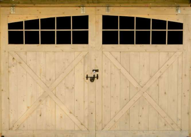 Accent your front sliding door with arched glass windows.  This option really finishes off your barn.